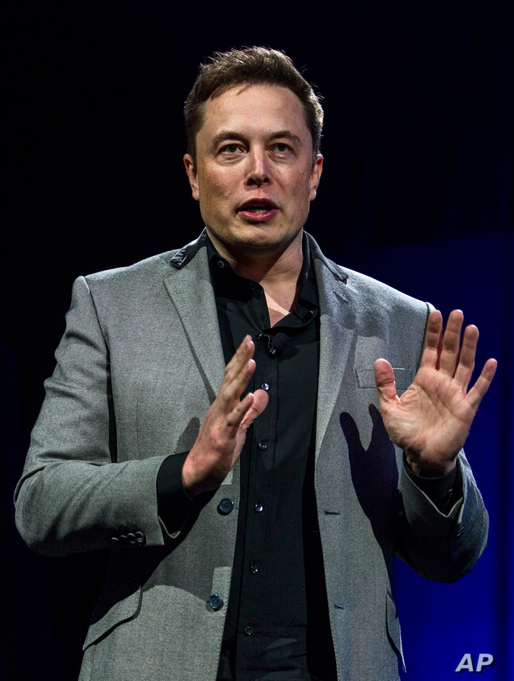 FILE - Elon Musk, CEO of Tesla Motors Inc., unveils the company's newest products in Hawthorne, Calif., April 30, 2015.