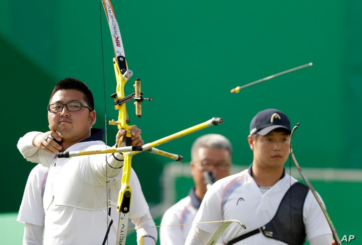 South Korea's Kim Woo-jin releases the arrow during the men's team archery competition at the Sambadrome venue during the 2016 Summer Olympics in Rio de Janeiro, Brazil, Aug. 6, 2016.