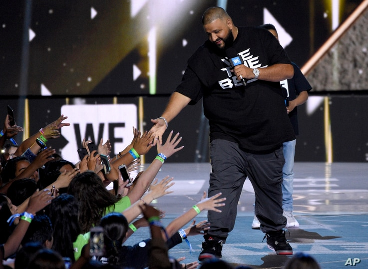 FILE - DJ Khaled greets the audience at WE Day California at the Forum in Inglewood, Calif.