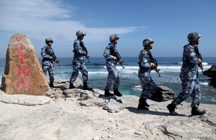 Soldiers of China's People's Liberation Army (PLA) Navy patrol at Woody Island, in the Paracel Archipelago, which is known in China as the Xisha Islands, Jan. 29, 2016.