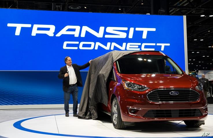 Actor Jim Belushi unveils the Ford Transit Connect Wagon at the 2018 Chicago Auto Show at McCormick Place in Chicago, Feb. 8, 2018. The 2019 Ford Transit Connect Wagon goes on sale this fall.