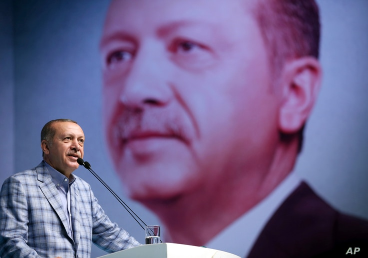 Turkey's President and leader of ruling Justice and Development Party Recep Tayyip Erdogan addresses his party members in Istanbul, June 25, 2017.