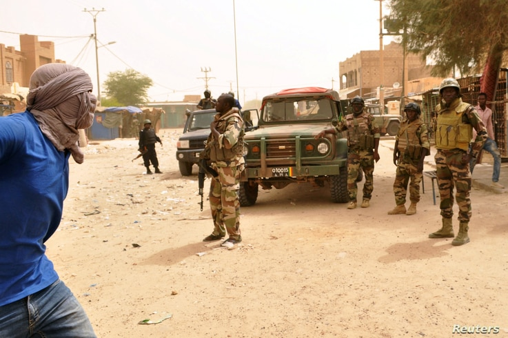 FILE - Soldiers patrol after election-related unrest, in which protesters fired shots into the air and torched vehicles in Timbuktu, Mali, July 25, 2018.