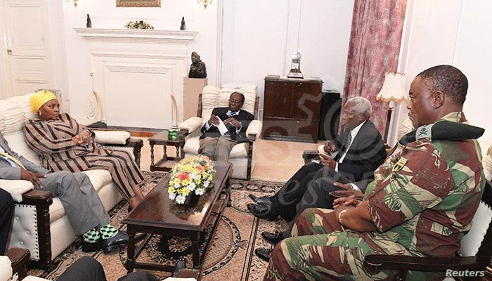 President Robert Mugabe, center, in a meeting with the ZDF Commander General Constantino Chiwenga, South African Minister of Defense Nosiviwe Mapisa-Nqakula (in yellow head wear), Zimbabwe Defense Minister Dr Sydney Sekeramayi and Zimbabwe State Secu...