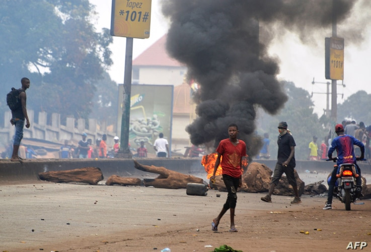 FILE - People demonstrate to denounce the results of the local elections, on Feb. 6, 2018 in Conakry.