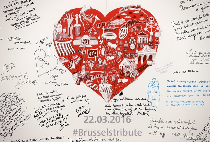 Messages are seen on a memorial for victims at Maelbeek metro station in Brussels, Belgium, April 25, 2016.