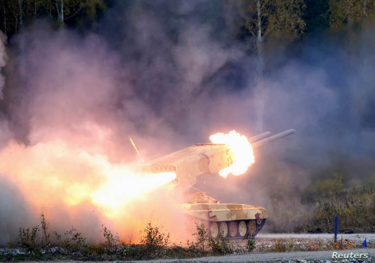 """A Russian """"TOS-1 Buratino"""" multiple rocket launcher fires during the """"Russia Arms Expo 2013"""" 9th international exhibition of arms, military equipment and ammunition, in the Urals city of Nizhny Tagil, September 25, 2013."""