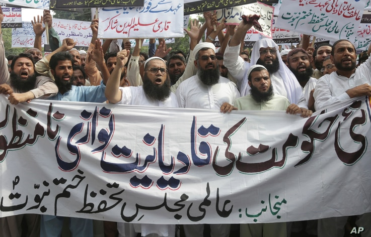 FILE - Pakistani Islamists protest the appointment of a minority Ahmadi Muslim as an adviser to the government, in Lahore, Pakistan, Sept. 7, 2018.