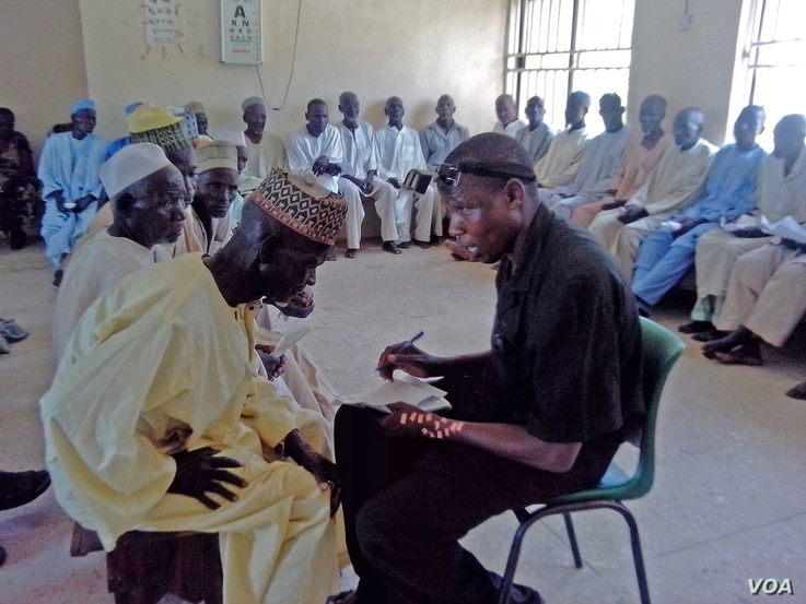 An optician interviews cataract patients at Gunduma Hospital System Council General Hospital, Dutse, before patients undergo surgery to prevent blindness.