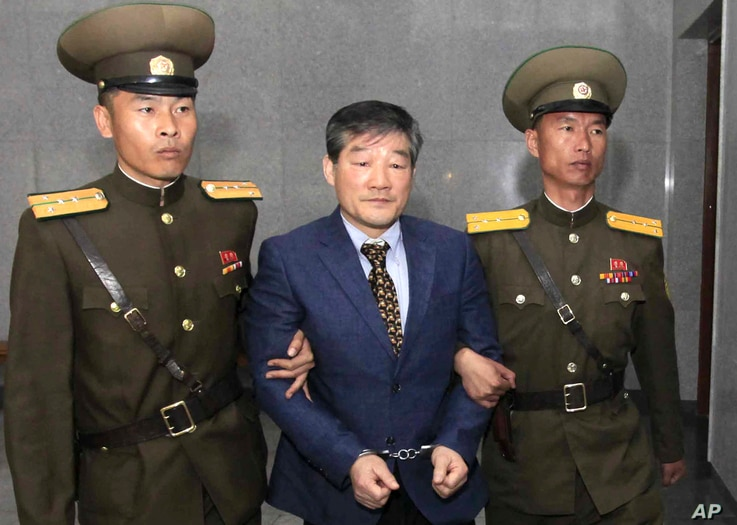 FILE -  Kim Dong Chul, center, a U.S. citizen detained in North Korea, is escorted to his trial in Pyongyang, North Korea.