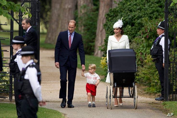 Britain's Prince William, Kate the Duchess of Cambridge, their son Prince George and daughter Princess Charlotte in a pram arrive for Charlotte's Christening at St. Mary Magdalene Church in Sandringham, England, July 5, 2015.