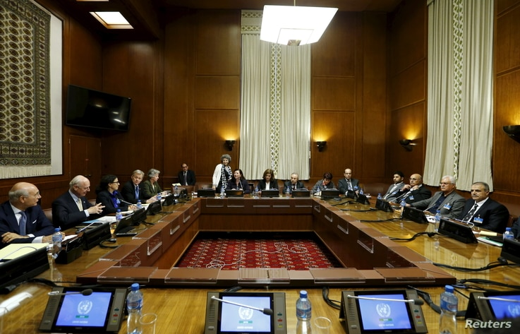 Asaad Al-Zoubi (R), head of the Syrian opposition delegation, and Salim al-Muslat (2nd R), spokesman for the High Negotiations Committee (HNC), attend peace talks with U.N. mediator for Syria Staffan de Mistura (2nd L) at the United Nations in Geneva...
