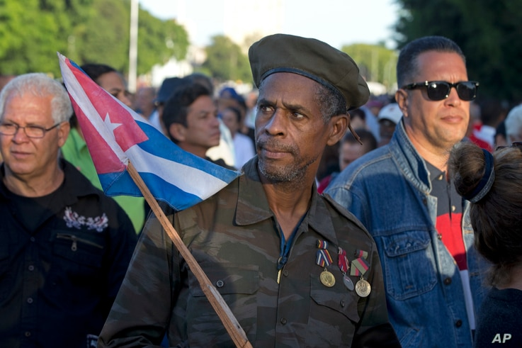 Ernesto Barbon, a veteran of the Angola war where Cuban troops fought in the 80s, waits in line to enter the Revolution PLaza, to render homage to Fidel Castro in Havana, Cuba, Nov. 28, 2016.
