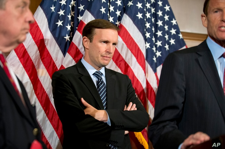 Sen. Chris Murphy, D-Conn., stands during a media availability on Capitol Hill in Washington, June 20, 2016.