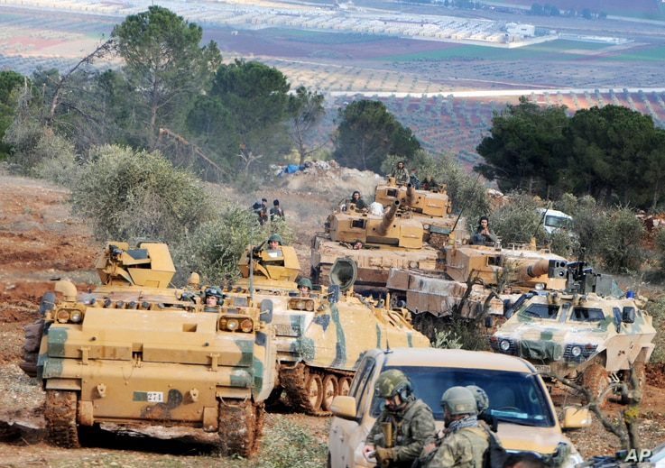 FILE - Turkish troops take control of Bursayah hill, which separates the Kurdish-held enclave of Afrin from the Turkey-controlled town of Azaz, Syria, Jan. 28, 2018.