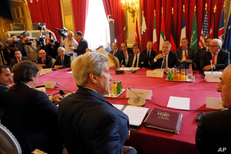 U.S. Secretary of State John Kerry, foreground center, attends a meeting on the conflict in Syria, in Paris, May 9, 2016, with representatives from France, Britain, Germany, Italy, Saudi Arabia, UAE, Qatar, Jordan, Turkey and the EU.