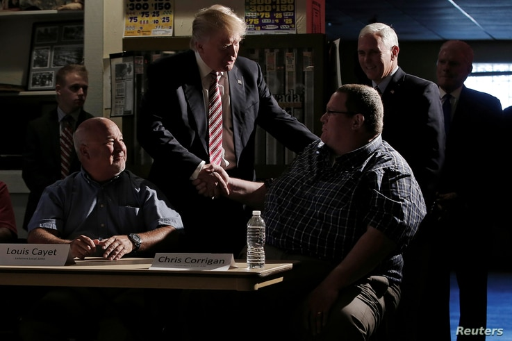 Republican nominee Donald Trump and his running mate Indiana Governor Mike Pence (back R) meet with local labor leaders and union members during a campaign stop in Brook Park, Ohio, US.  Sept. 5, 2016.
