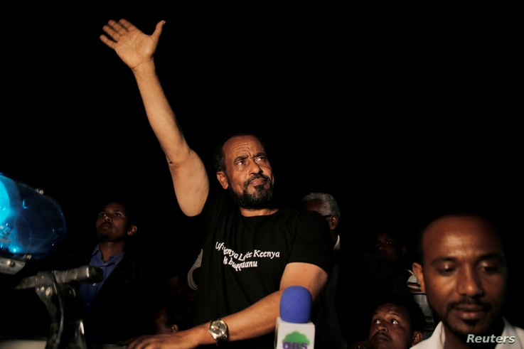 Bekele Gerba, secretary general of the Oromo Federalist Congress (OFC), waves to his supporters during the celebration after his release from prison in Adama town of Oromia region, Ethiopia Feb. 13, 2018.
