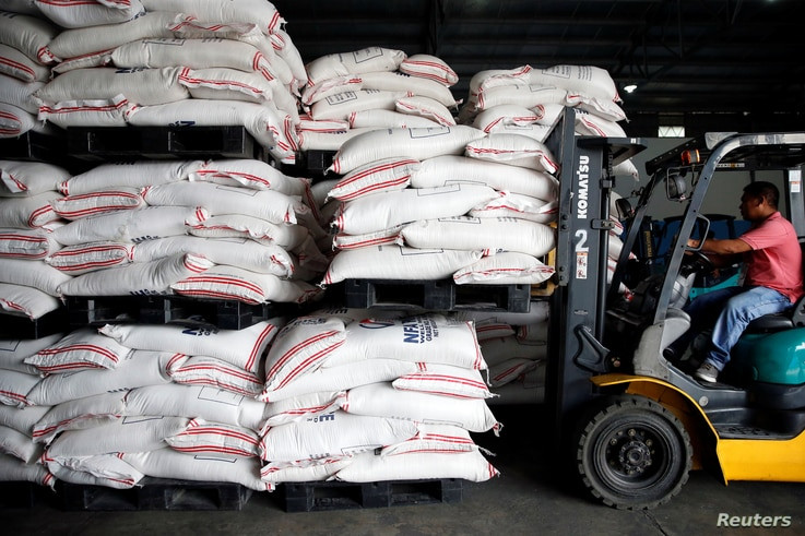 A volunteer operates a forklift to carry sacks of rice for victims of Super Typhoon Mangkhut at the Department of Social Welfare and Development, National Relief Operations Center in Pasay City, Metro Manila, in Philippines, Sept. 17, 2018.