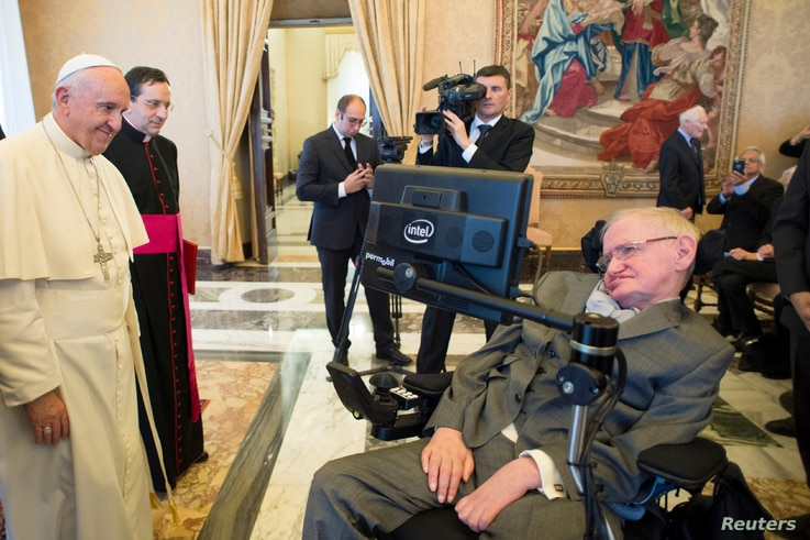Pope Francis greets Stephen Hawking, theoretical physicist and cosmologist, during a meeting with the Pontifical Academy of Sciences in Vatican, Monday, Nov. 28, 2016.