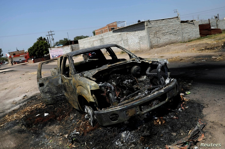 The wreckage of a car that was burnt in a blockade set by members of the Santa Rosa de Lima Cartel to repel security forces during an anti-fuel theft operation is pictured in Santa Rosa de Lima, in Guanajuato state, Mexico, March 6, 2019.
