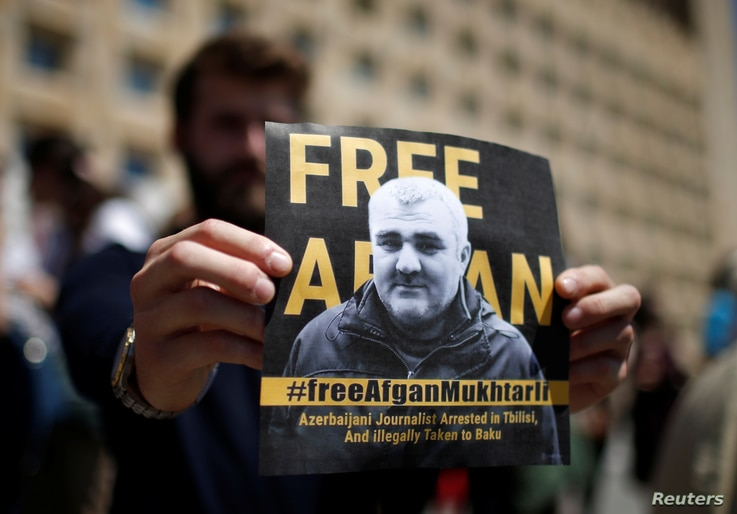 A man attends a rally to support Azerbaijani journalist Efqan Mukhtarli, who was abducted in Tbilisi on May 29 and now is in detention in Baku, in Tbilisi, Georgia, May 31, 2017.