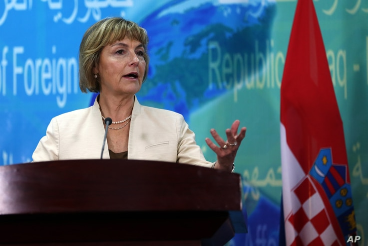 FILE - Croatian Foreign Minister Vesna Pusic speaks during a press conference with her Iraqi counterpart Ibrahim al-Jaafari in Baghdad, Iraq, May 3, 2015.