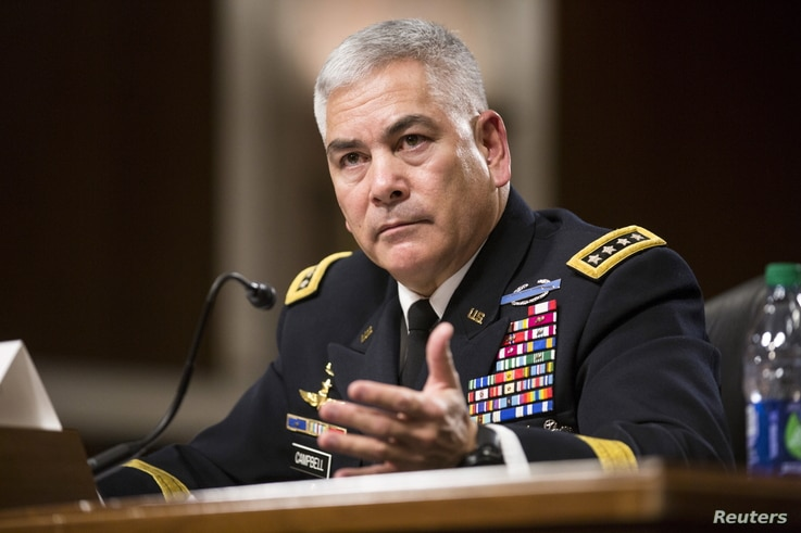 """U.S. Army General John Campbell, commander of the Resolute Support Mission and United States Force - Afghanistan, testifies before a Senate Armed Services Committee hearing on """"The Situation in Afghanistan"""" on Capitol Hill in Washington, Oct. 6, 2015..."""