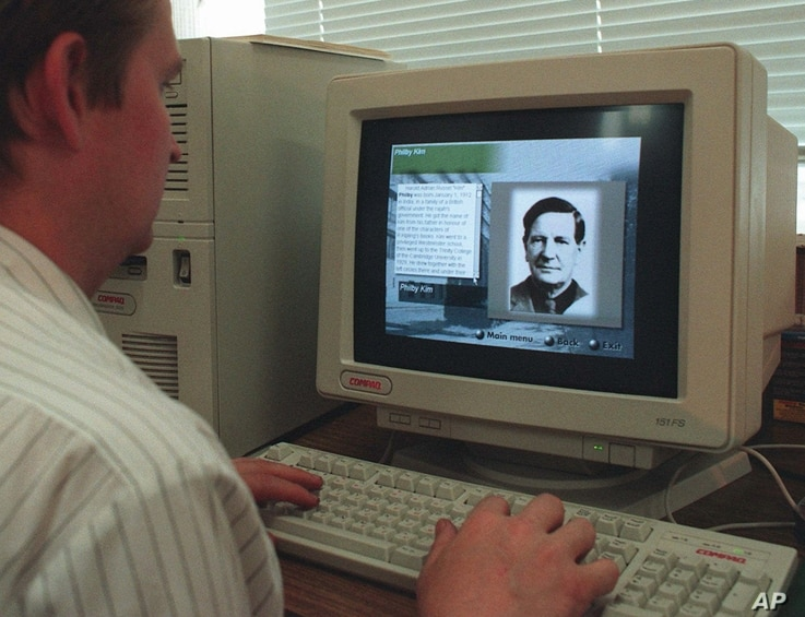 FILE - An operator at a CD-ROM production company inputs information on July 16, 1996 about Soviet Spy Kim Philby.