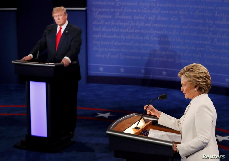Republican presidential nominee Donald Trump listens as Democratic presidential nominee Hillary Clinton speaks during their third and final 2016 presidential campaign debate at UNLV in Las Vegas, Oct. 19, 2016.