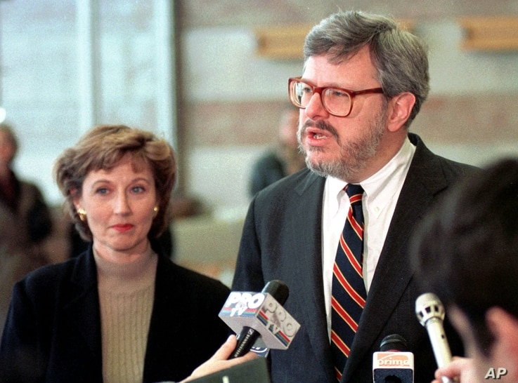 FILE - James Rosapepe, the  United States Ambassador to Romania, talks to reporters as his wife, Sheilah Kast, looks on shortly after arriving in Bucharest, Feb. 1, 1998.