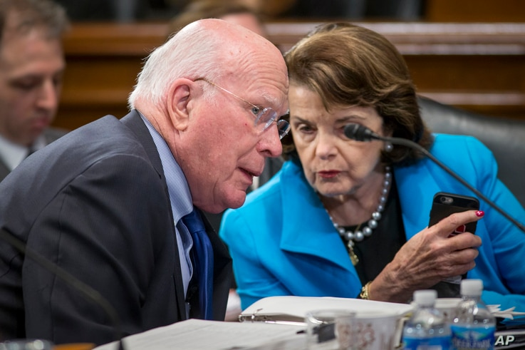 FILE - Democratic Senator Patrick Leahy (L) speaks with colleague, Senator Dianne Feinstein, during a meeting on Capitol Hill in Washington, March 10, 2016.