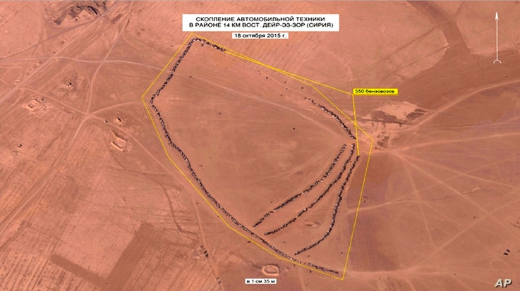 In this photo made from video taken from Russian Defense Ministry official web site on Oct. 1, 2015, an aerial image of what they purport shows lines of oil trucks 14 km (8.8 miles) east of Dayr-az-Zawr, Syria.