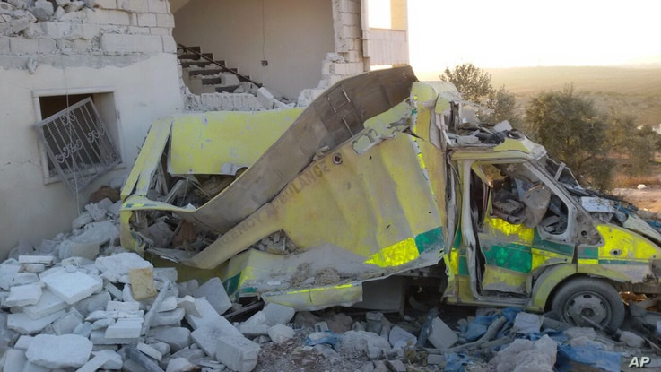 This photo provided by the Shafak Charity Organization, which has been authenticated based on its contents and other AP reporting, shows an ambulance destroyed following four consecutive airstrikes on a medical facility dedicated to women in northern...