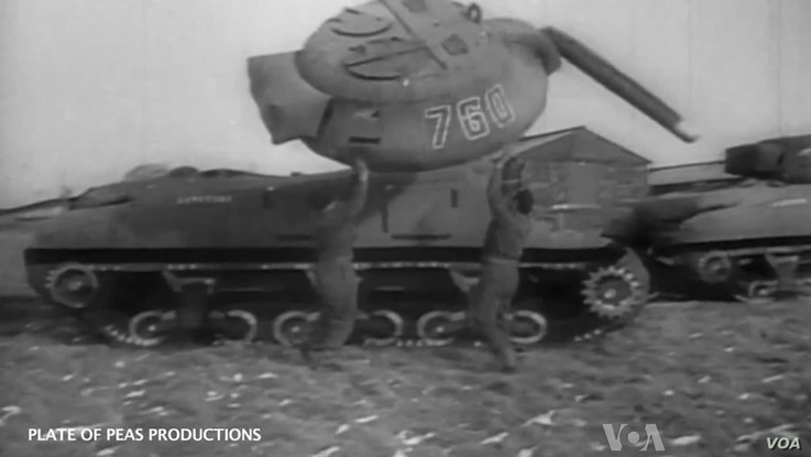 Members of the Ghost Army work with an inflatable tank, one of hundreds of props used to deceive the enemy during World War ll. (Courtesy Plate of Peas Productions)