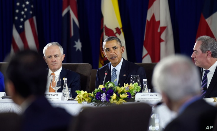 President Barack Obama, center, sitting next to Australia's Prime Minister Malcolm Turnbull, left, and U.S. Trade Representative Michael Froman, right, speaks during a meeting with other leaders of the Trans-Pacific Partnership countries in Manila,...
