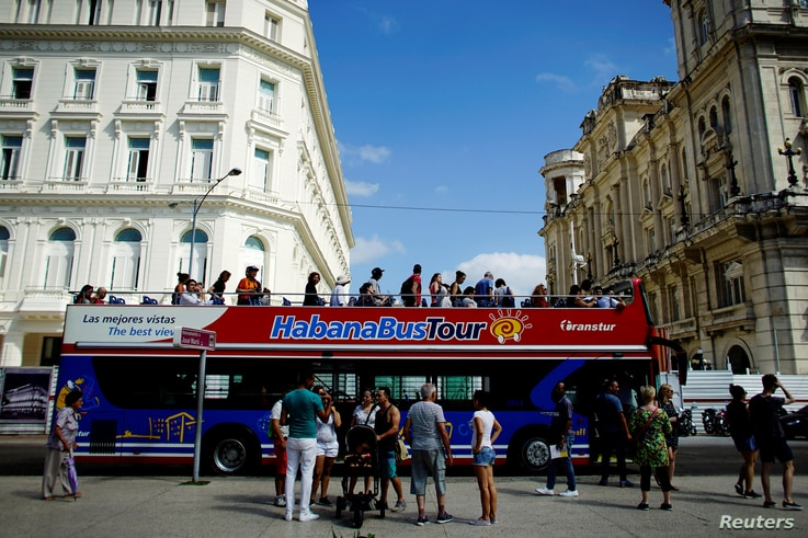 Tourists disembark from a Chinese-made double-decker Yutong bus in Havana,Feb. 10, 2017.