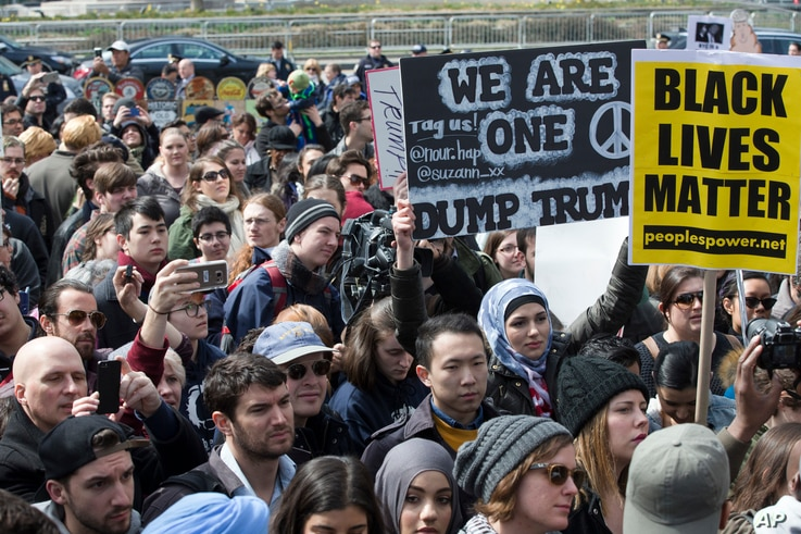 Demonstrators assemble outside the Trump International Hotel and Tower during an anti-Donald Trump protest in New York, March 19, 2016.