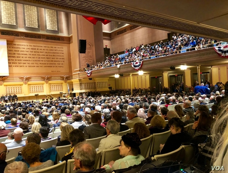 At the interfaith service, 2300 attendees inside heard a parade of religious leaders at the podium, many speaking of love and unity.