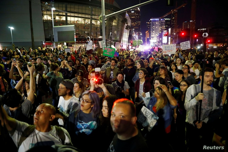 Demonstrators gather near the Staples Center during a march through the streets of downtown Los Angeles in protest following the election of Republican Donald Trump as President of the United States in Los Angeles, CA, Nov. 10, 2016.