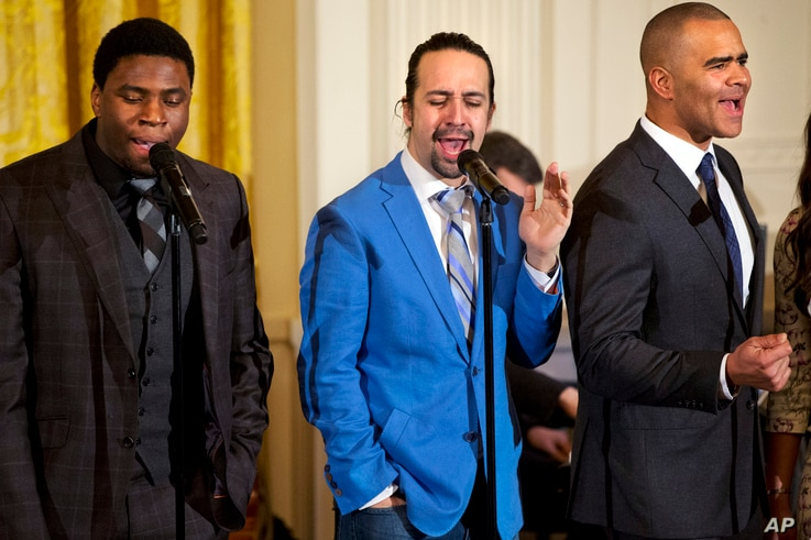 """FILE - Actor Okieriete Onaodowan, left, actor Lin-Manuel Miranda and actor Christopher Jackson perform the song """"Alexander Hamilton"""" from the Broadway play """"Hamilton"""" in the East Room of the White House in Washington, March 14, 2016."""