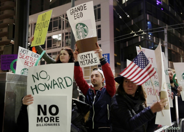 People protest outside before former Starbucks CEO Howard Schultz speaks during his book tour in Seattle, Jan. 31, 2019.