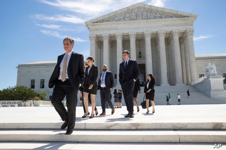People leave the Supreme Court in Washington, June 26, 2017, as justices issued their final rulings for the term.
