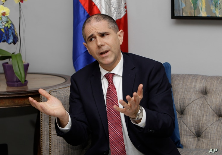 U.S. Assistant Secretary of State for Consular Affairs Carl C. Risch gestures during a news conference in Phnom Penh, Cambodia, Feb. 9, 2018. Rich was in Cambodia to talk with senior government officials about resuming the repatriation of convicted C...