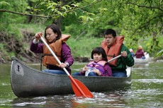 Students paddle along the Kickapoo River, where a 20-year preservation venture stopped encroachment by developers.