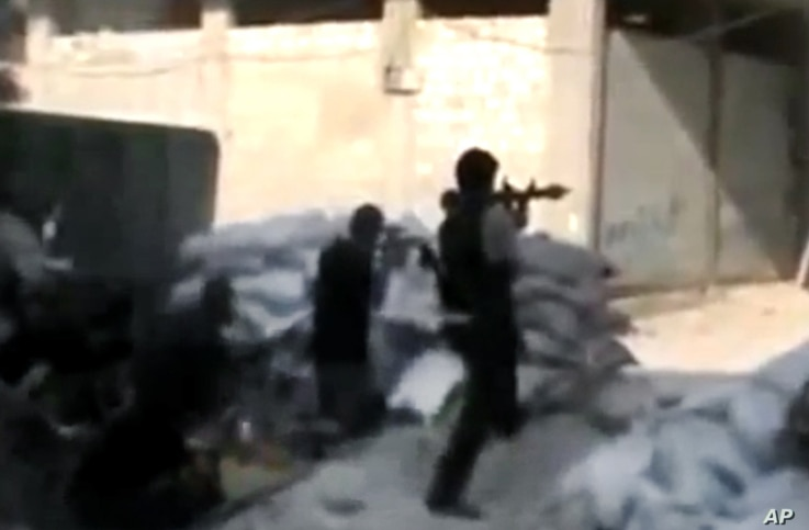 Free Syrian Army soldiers during clashes with Syrian government forces in Damascus, July 15, 2012. (Image taken from amateur video.)