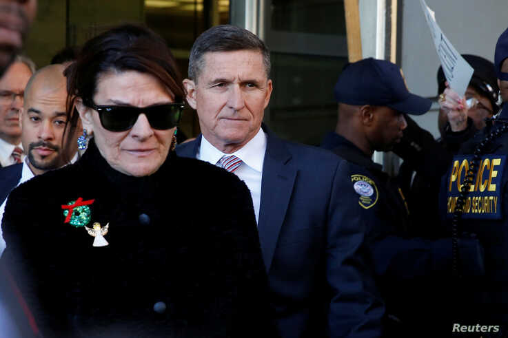 Former U.S. national security adviser Michael Flynn departs after his sentencing was delayed at U.S. District Court in Washington, U.S., Dec.18, 2018.