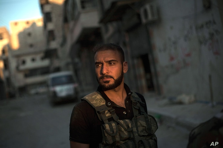 A Free Syrian Army sniper stands at the front line in the Amariya district in Aleppo, September 19, 2012.