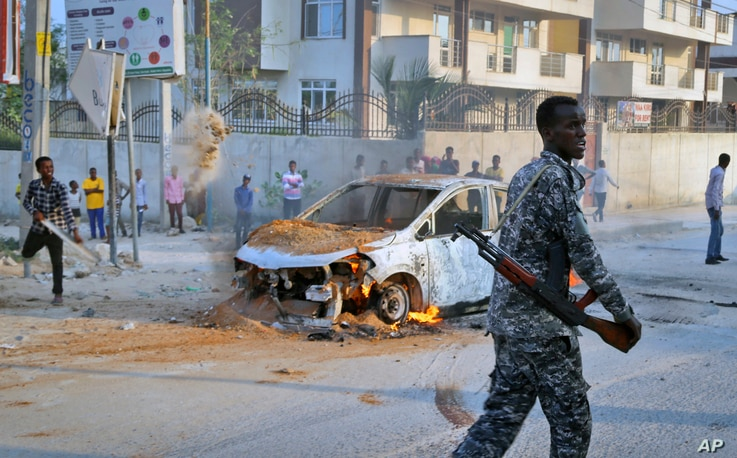 A Somali soldier attends the scene after a bomb attack near the office of the International Committee of the Red Cross in Mogadishu, Somalia, March 28, 2018.
