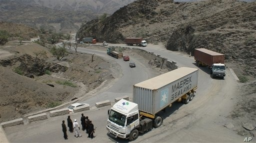 Border guards check trucks en-route to neighboring Afghanistan in Pakistan's tribal area of Khyber, July 4, 2012.